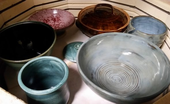 glazed pottery items in the kiln