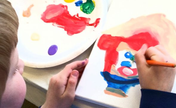image of child painting with Artingales